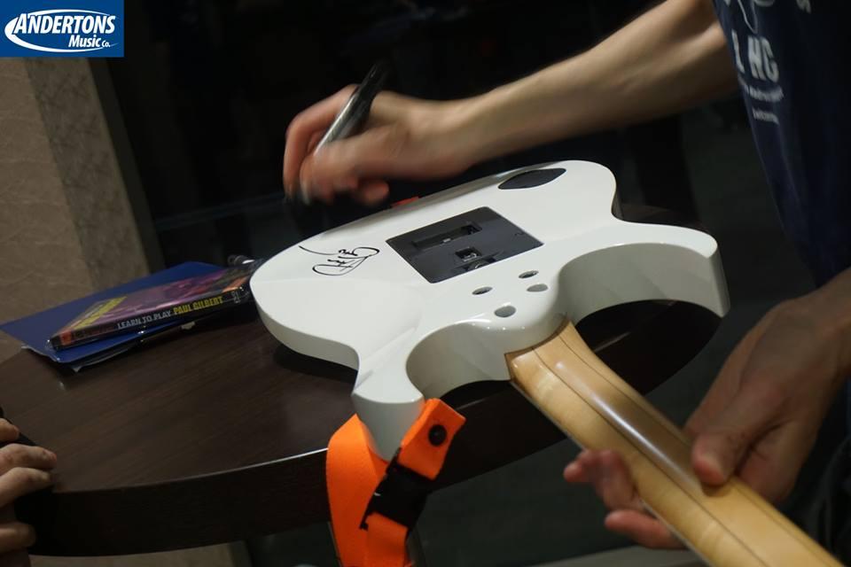 signing guitar